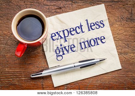 expect less, give more advice - motivation or self improvement concept - handwriting on a napkin with a cup of coffee