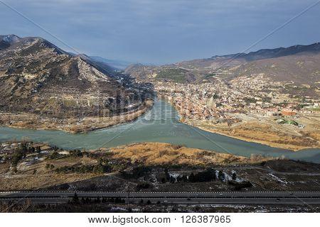 Jvari. Georgia. Panoramic view to the the confluence of the Mtkvari and Aragvi rivers and the town of Mtskheta.