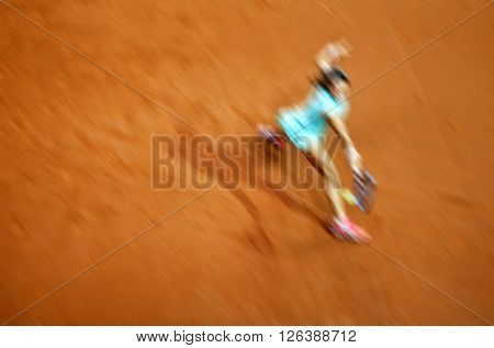 Blurred abstract background of woman playing tennis in court