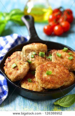 Chicken Cutlets In A Skillet.