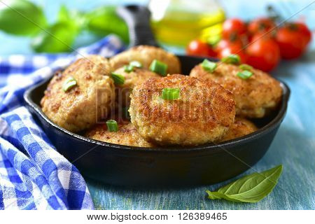 Chicken Cutlests In A Skillet.