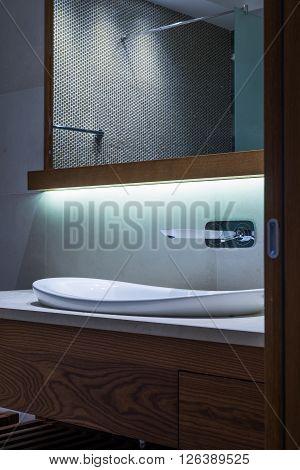 Lavatory And Mirror In Modern Bathroom Interior