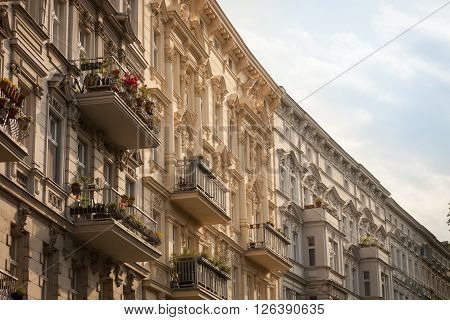 Beautifully restored stucco facades of apartment buildings