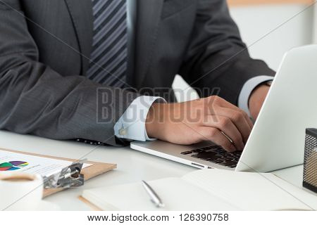 Close-up Of Businessman Hands Working On Computer