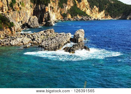 rocks surrounded by clear blue Ionian sea in Greece