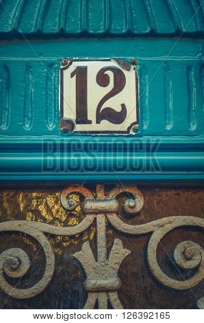 Detail Of An Apartment Number On A Rustic Blue Door In Paris