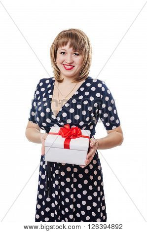 The girl in a dress holds in hand a white box a red bow