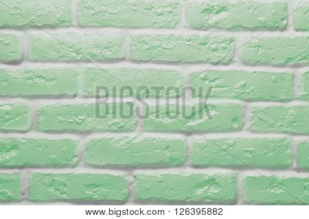 Green brick wall texture or background, abstract