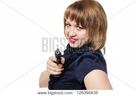 The dangerous young woman with long hair shoots from the pistol