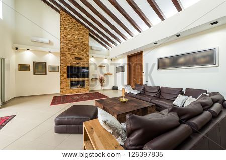 Interior of luxury attic with fireplace in modern home