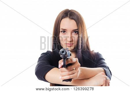 The serious young girl aims to shoot from the gun