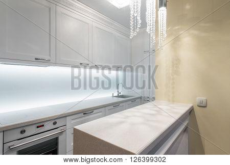 Countertop in modern white white kitchen interior
