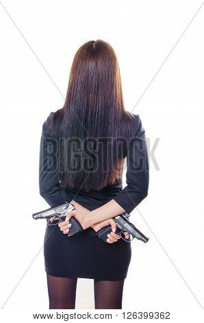 The young woman keeps in a dress pistols behind the back