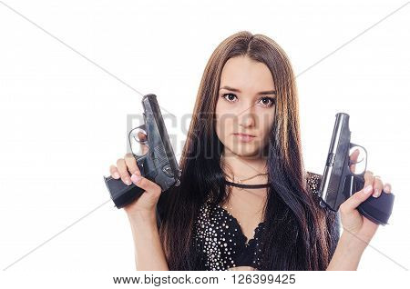 The serious and beautiful girl with pistols looks up