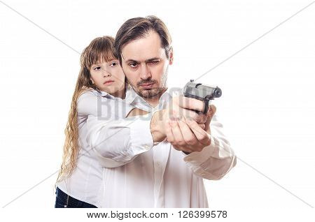 The serious man with the child and the pistol in hands