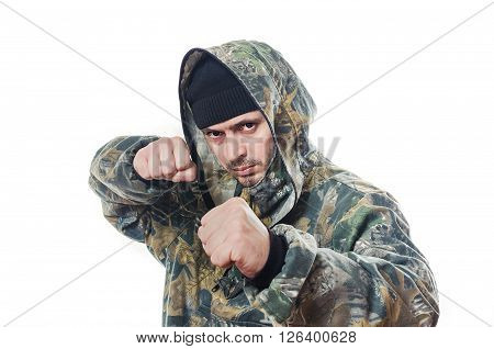 The serious man in a camouflage shakes fists