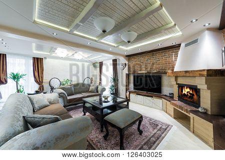 Big modern living room with sofa and fireplace