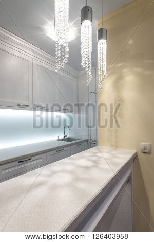 Countertop and sink in contemporary white kitchen