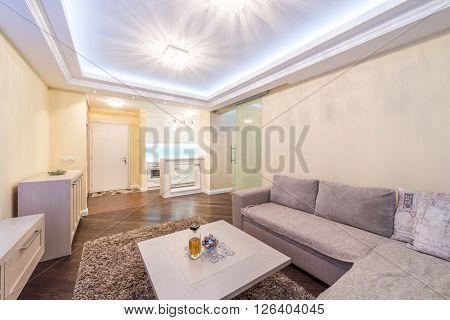 Modern living room with white sofa and plasma