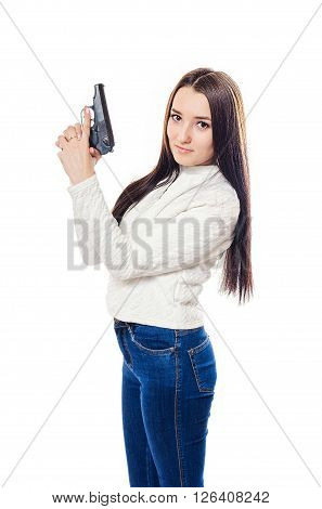 The beautiful girl in a white sweater and jeans from the pistol