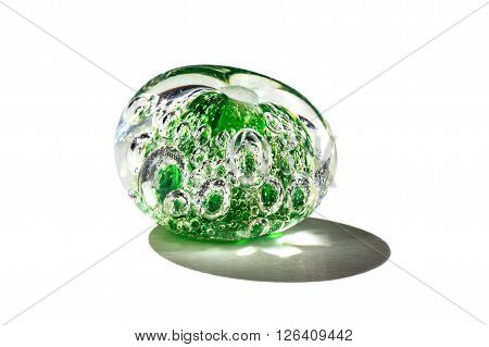 Hand made green with bubbles glass bead on white background