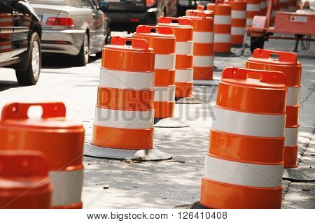 traffic cones by the side of street