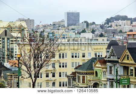 At Alamo Square, San Francisco, USA with classic buildings and modern buildings