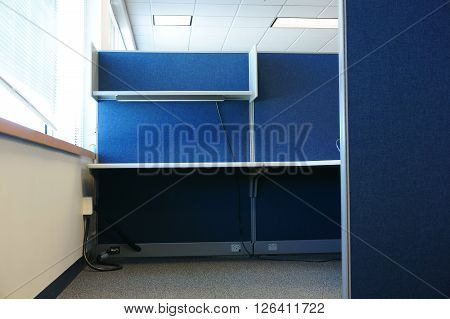 empty cubicle in office building for design