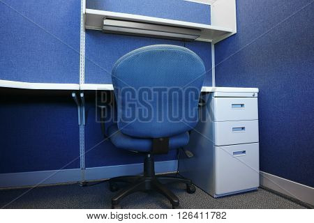 desk and chair in office cubicle, nobody