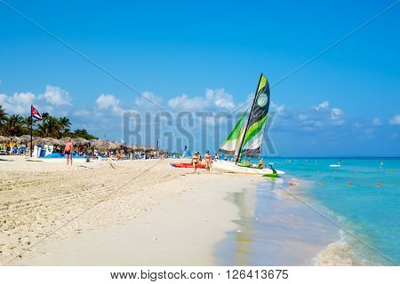 HAVANA,CUBA- MARCH 17,2016 : Tourists at the beautiful beach of Varadero in Cuba