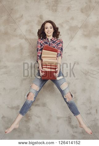 Cute woman with heap of books