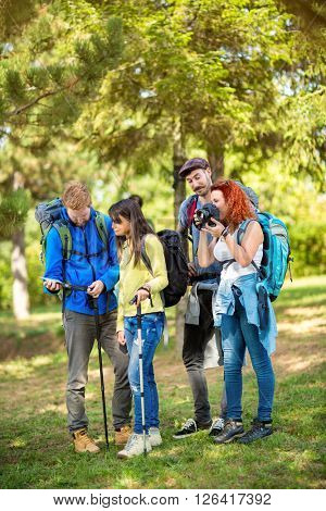 Young scouts makes pause in nature to take pictures and view path