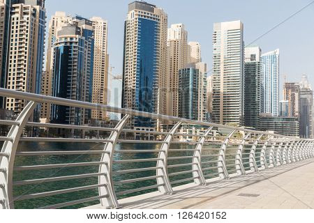 cityscape, travel, tourism and urban concept - Dubai city business district skyscrapers and seafront