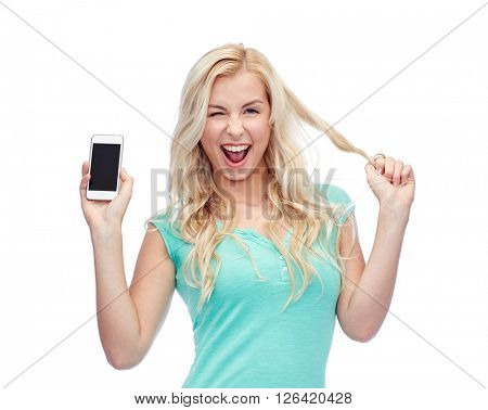 emotions, expressions, technology and people concept - smiling young woman or teenage girl showing blank smartphone screen and winking