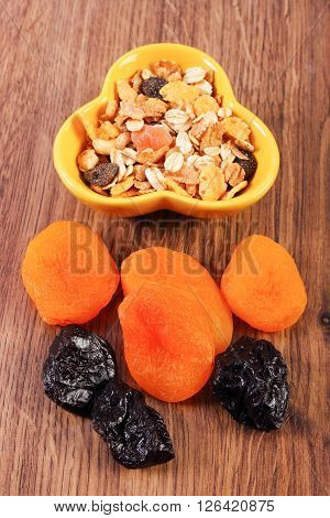 Portion of dried fruits and muesli in bowl,  increase metabolism ingredients with dietary fiber