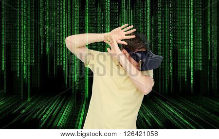 3d technology, virtual reality, entertainment and people concept - scared young man with virtual reality headset or 3d glasses playing game and covering from something over binary code background