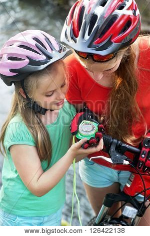 Bikes cycling children girl wearing helmet look at compass.