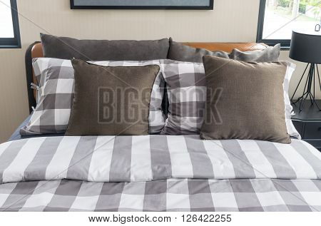 Bed And Brown Pillows In Modern Bedroom