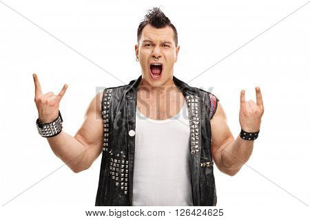Excited punk rocker making rock hand gesture and looking at the camera isolated on white background