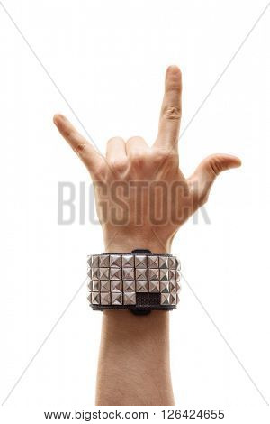 Vertical studio shot of a hand making a rock sign isolated on white background