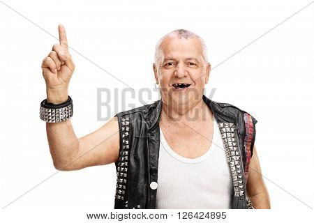 Mature punk rocker pointing up with his finger and looking at the camera isolated on white background