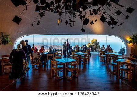 EL RIO VIEWPOINT, LANZAROTE ISLAND, SPAIN - SIRCA JANUARY 2016: People sit in the cafe and look on the great view of Graciosa island at El Rio viewpoint on the north of Fuerteventura island