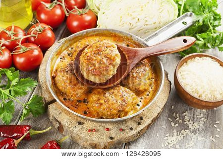 Meat Cutlets With Cabbage And Rice