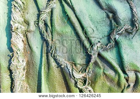 abstract uneven pattern from threads and ropes of green color for the textured background or for wallpaper