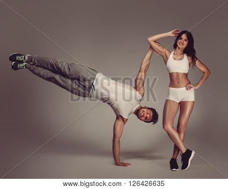 Young athletic beautiful couple indoors.  Studio shot