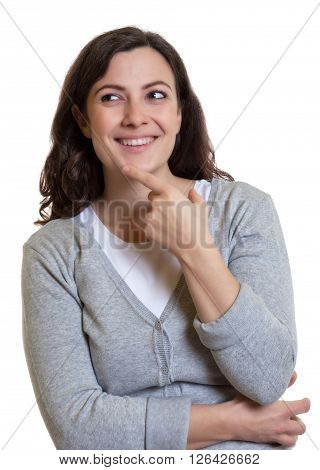 Thinking caucasian woman with dark hair on an isolated white background for cut out