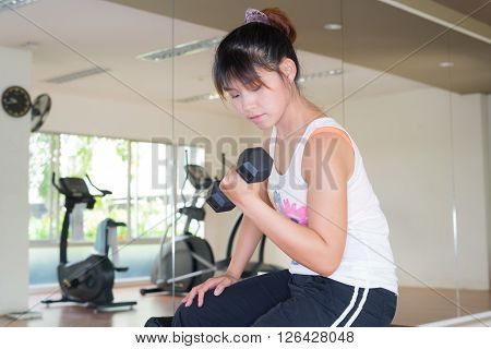 Exercise series : Asian woman lifting weights on the bench