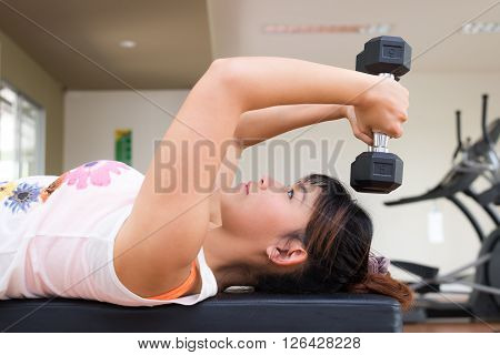 Exercise series Thai woman do bench press