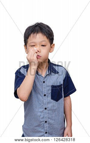 Young asian boy wipes his nose by tissue paper