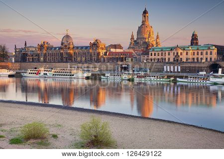 Dresden. Image of Dresden, Germany during sunset with Elbe River in the foreground.